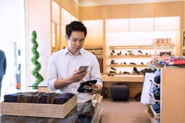 Customer using phone in store