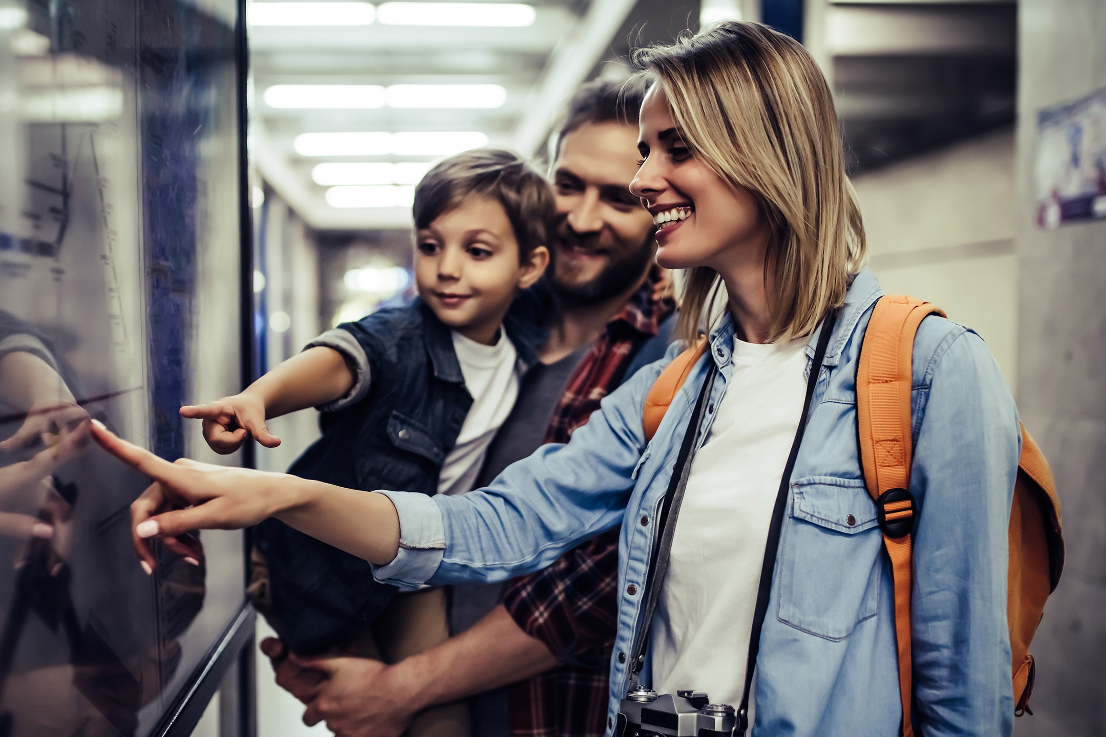 Family of tourists interacting with digital transit map