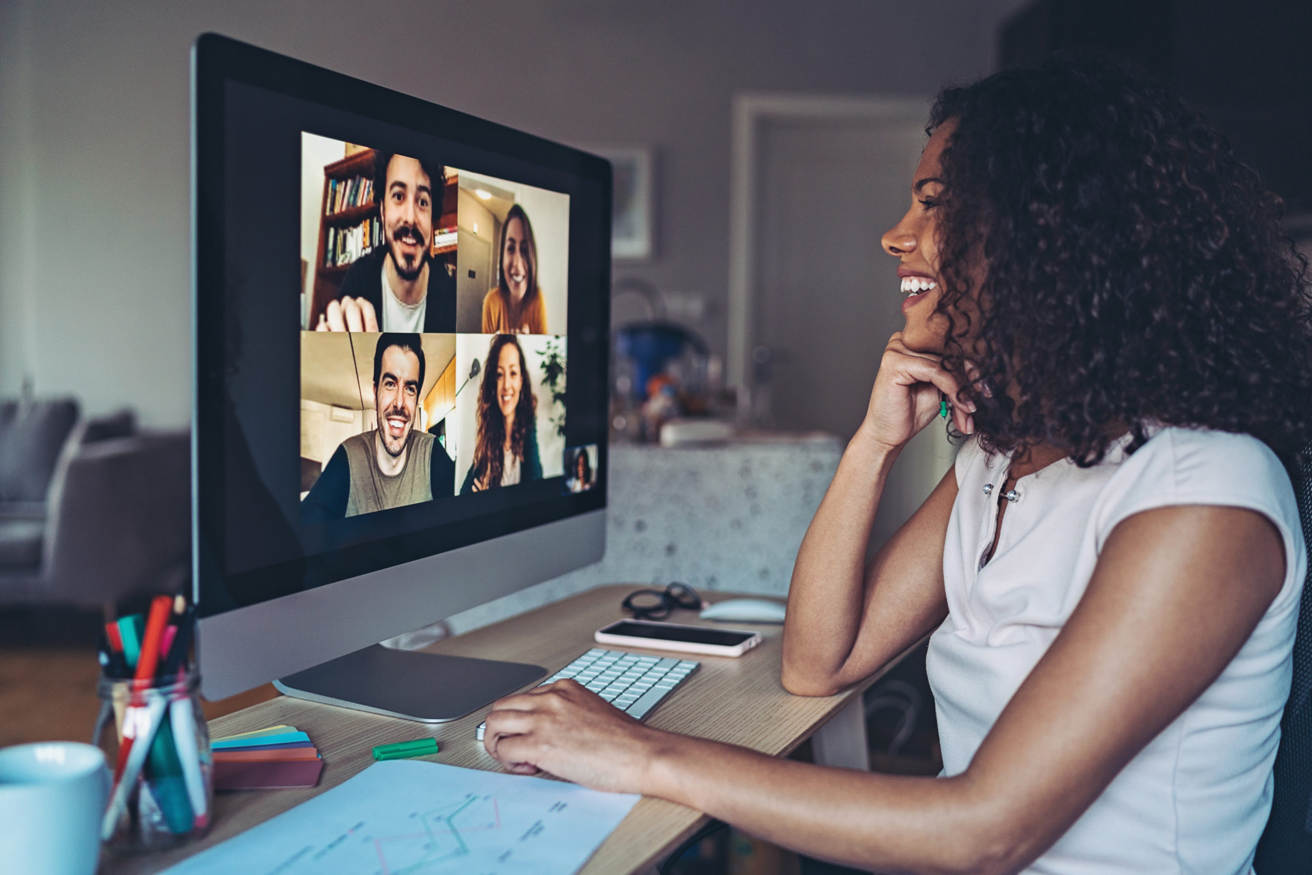 Woman on virtual call with colleagues