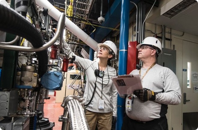 Two Electrical Engineers working at a power plant