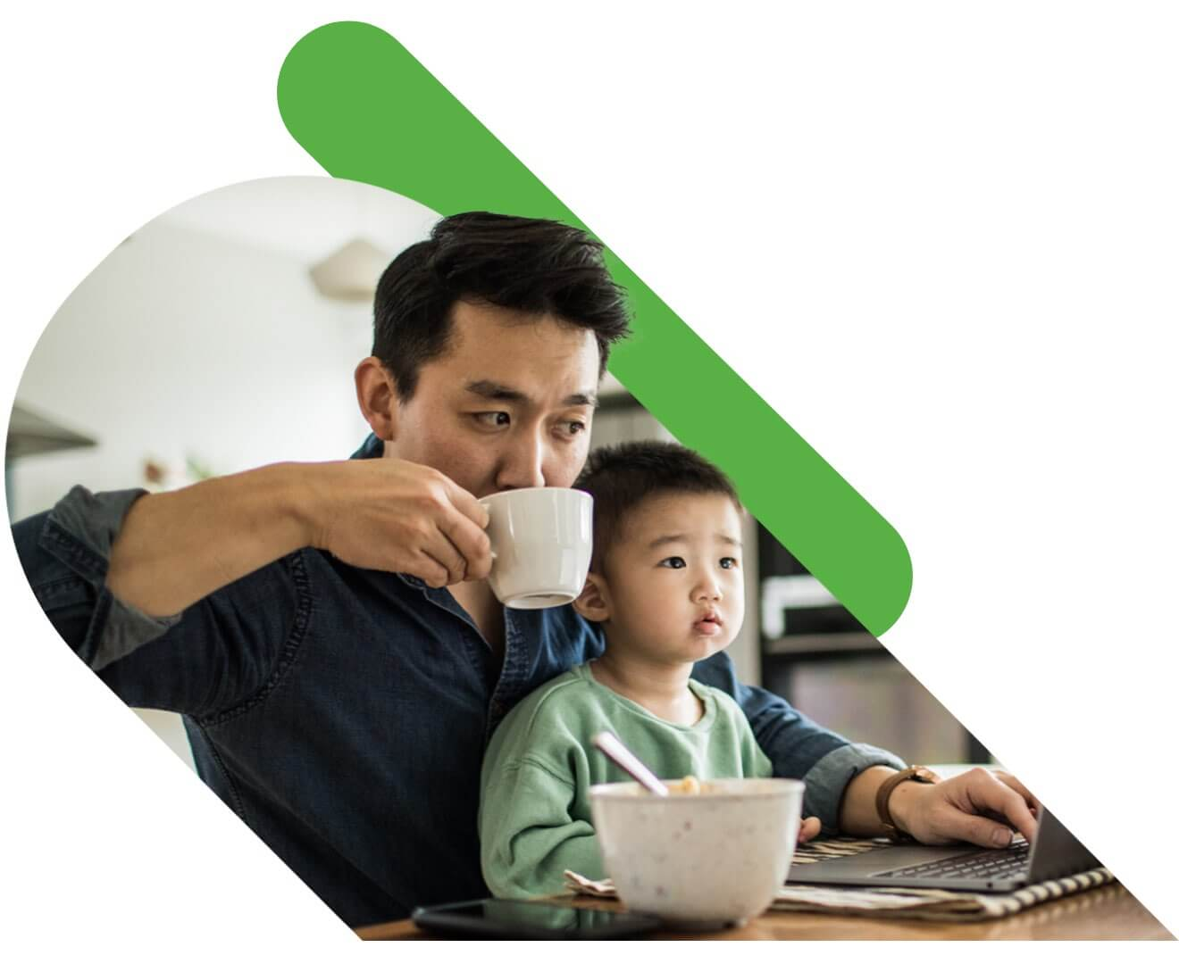 man and son working on a laptop